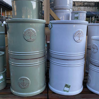 Ceramic plant pots in pastel green and pastel blue