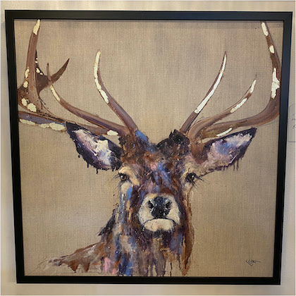 Framed canvas of stag head