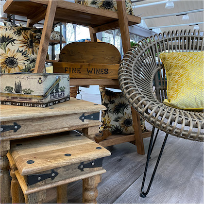 Wooden furniture and grey rattan nesting chair