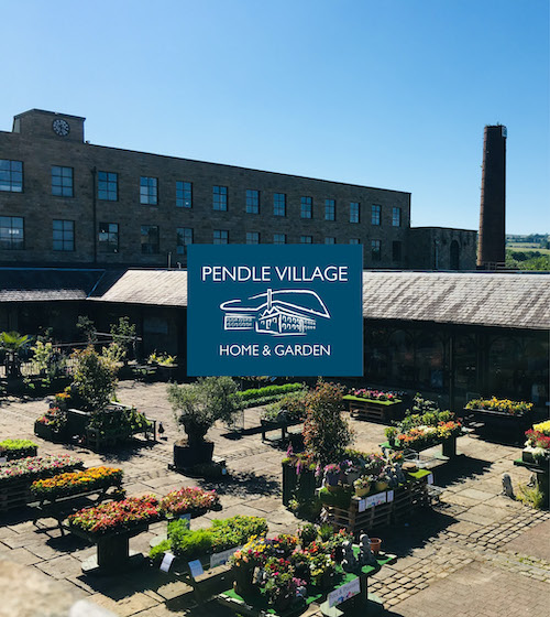 Pendle Village mill exterior and courtyard garden centre